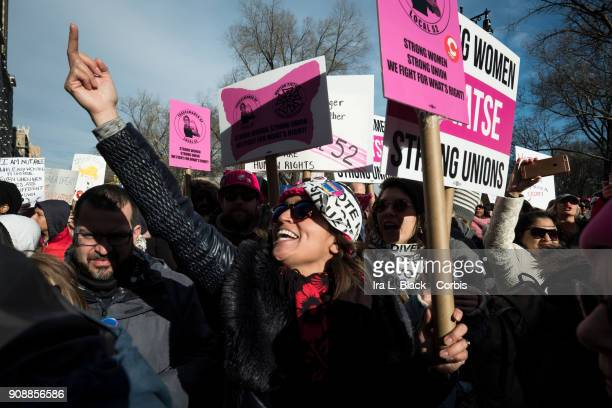 A demonstrator holds up a finger toward Trump International Hotel and Tower during the second annual Women's March in the borough of Manhattan in New...