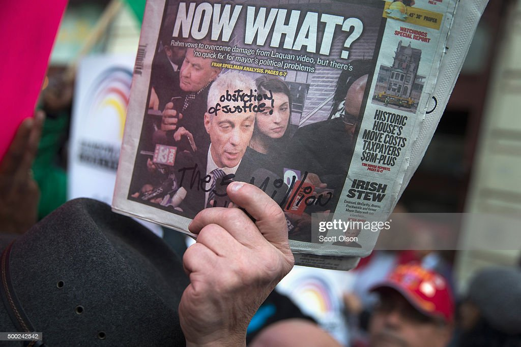 A demonstrator holds up a newspaper with a picture of Chicago Mayor Rahm Emanuel on the front during a march down State Street to protest the death of Laquan McDonald and the alleged cover-up that followed on December 6, 2015 in Chicago, Illinois. Chicago Police officer Jason Van Dyke shot and killed 17-year-old McDonald on October 20, 2014, hitting him with 16 bullets. Van Dyke was charged with murder more than a year after the shooting after a judge ordered the release to the public of a video which showed McDonald backing away from Van Dyke while being shot.