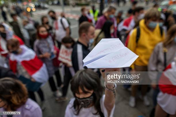 Demonstrator holds up a paper plane with the lettering 'Free Belarus' and 'Free Roman Protasevich' during a demonstration of Belarusians living in...