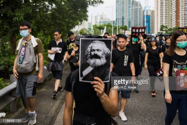 Demonstrator holds up a photo of Karl Marx as he takes part in a protest in the Tseung Kwan O district on Aug. 04, 2019 in Hong Kong, China....