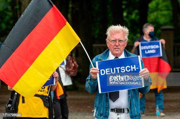 A demonstrator holds up a placard reading Germany during a protest against lockdown measures due to the new coronavirus COVID19 pandemic in Berlin on...