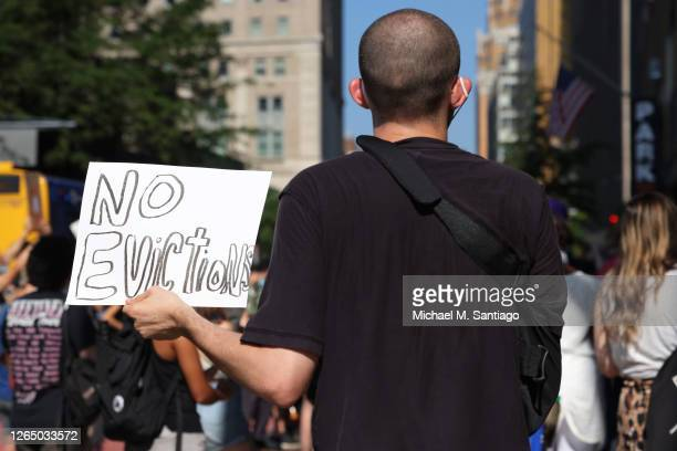 Demonstrator holds up a sign as he listens to speakers during a 'Resist Evictions' rally to protest evictions on August 10, 2020 in New York City....