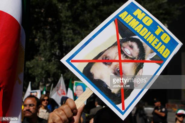 A demonstrator holds up a sign during an antiIran protest outside the United Nations before the scheduled arrival of Iranian President Mahmoud...