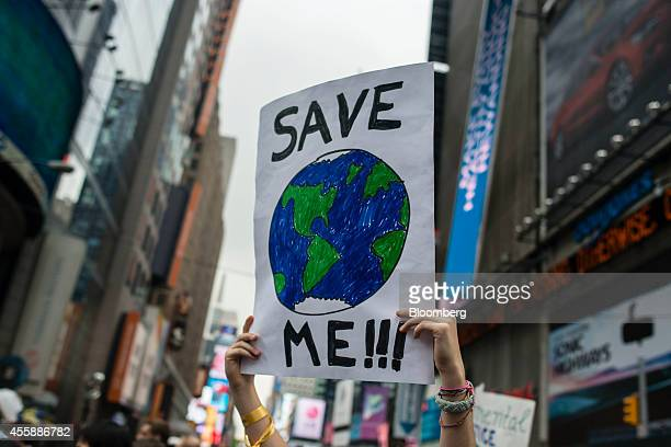 A demonstrator holds up a sign during the People's Climate March in New York US on Sunday Sept 21 2014 The United Nations 2014 Climate Summit is...