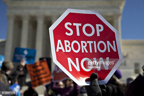 A demonstrator holds up a sign in support of prolife rights outside the US Supreme Court in Washington DC US on Wednesday March 2 2016 Supreme Court...