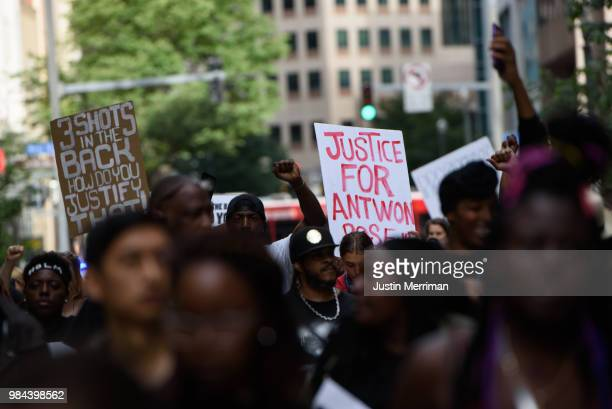 A demonstrator holds up a sign that reads Justice for Antwon Rose during a protest a day after the funeral for Rose on June 26 2018 in downtown...