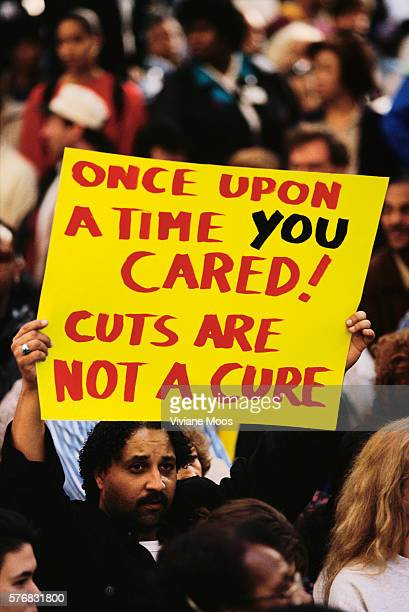 A demonstrator holds up a sign which says 'Once Upon a Time You Cared Cuts Are Not a Cure' at a health care march and rally sponsored by the Keep...