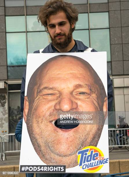 A demonstrator holds up a sign with the image of accused sexual predator Harvey Weinstein and the words Tide Challenge One year after the...