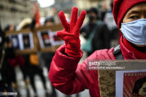 Demonstrator holds up a three-finger salute, during a protest against the military coup and to demand the release of detained Myanmar civilian leader...
