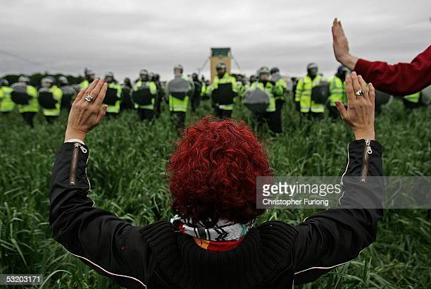 Demonstrator holds up her hands in front of a line of police during disturbances at the G8 summit on July 6, 2005 near Gleneagles, Scotland. The G8...