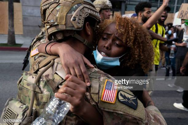 A demonstrator hugs a member of the National Guard during a march in response to George Floyd's death on June 2 2020 in Los Angeles California Floyd...