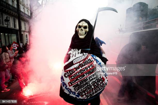 A demonstrator in a disguise representing death attends the demonstration against the breakup of the public railway service on April 3 2018 in Paris...
