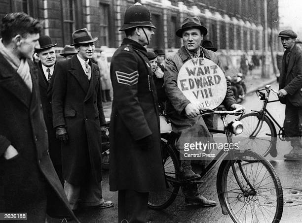 A demonstrator in Downing Street London during the abdication crisis King Edward VIII abdicated on December 11 on account of general disapproval of...