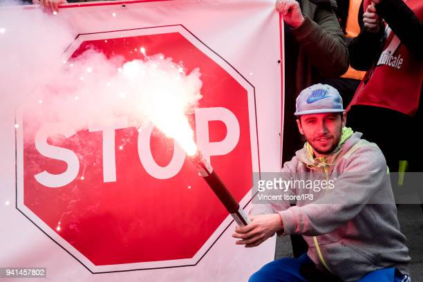 A demonstrator in front of a stop sign during the demonstration against the breakup of the public railway service on April 3 2018 in Paris France...