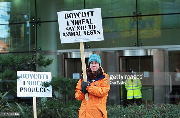 Demonstrator in front of L'Oreal headquarters calling for a day's boycott of L'Oreal products to protest against the fact that they test their...