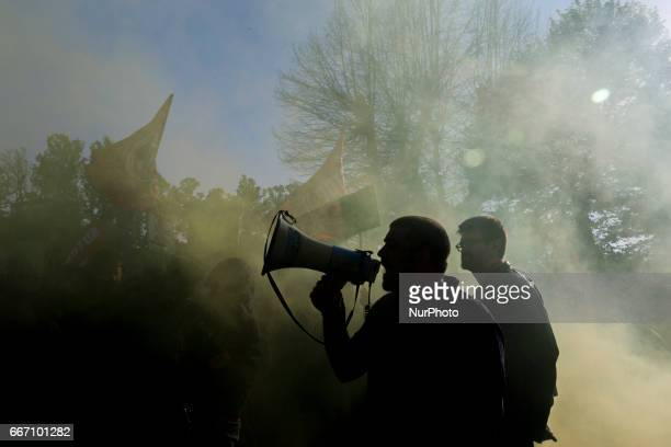 A demonstrator in Lucca Italy on April 10 2017 during a demonstration against G7 Foreign Minister Meeting in Lucca on April 1011 2017