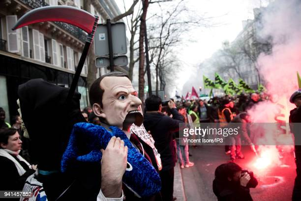A demonstrator in the wearing an Emmanuel Macron mask is seen at the demonstration against the breakup of the public railway service on April 3 2018...