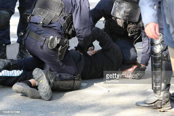 A demonstrator is arrested by anti riot gendarmes during a rally called by several French workers unions on October 9 2018 in Paris as part of a...