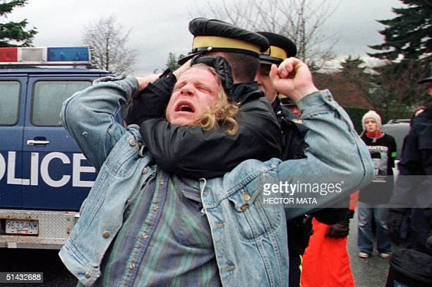 Demonstrator is arrested by members of the Royal Canadian Mounted Police 25 November at the University of British Columbia in Vancouver, Canada,...