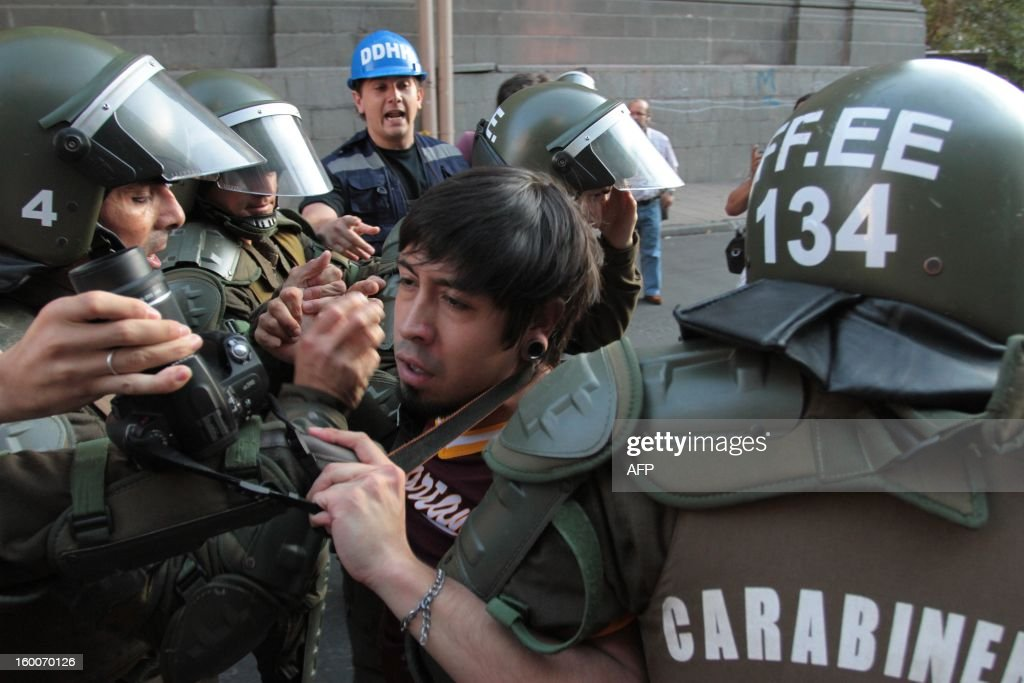 A demonstrator is arrested by riot police during a march of the Peoples' Summit 'for Social Justice, International Solidarity and in Defence of the Commons', held in the sidelines of the weekend's CELAC-EU Summit, in Santiago on January 25, 2013. More than 40 Heads of State and Government of the Community of Latin American and Caribbean States (CELAC) and the European Union (EU) will meet on January 26 and 27 to promote a strategic partnership between the two regions.