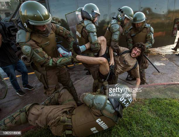 A demonstrator is arrested by riot police during a protest for the death of Mapuche Camilo Catrillanca in Santiago on November 15 2018 Catrillanca...