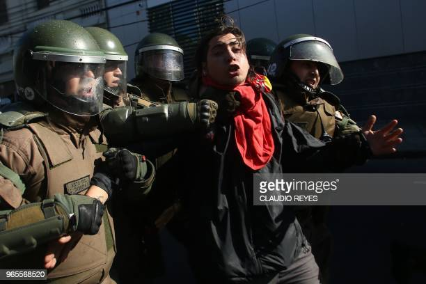 A demonstrator is arrested by riot police in the surroundings of the Congress in Valparaiso Chile while Chilean President Sebastian Pinera delivers...