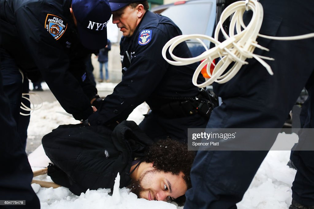 A demonstrator is arrested during a protest and march against the immigration polices of President Donald Trump and other issues on February 11, 2017 in New York City. Trump announced on Friday that he is considering rewriting his executive order temporarily barring refugees and citizens of seven Muslim-majority countries from entering the United States.