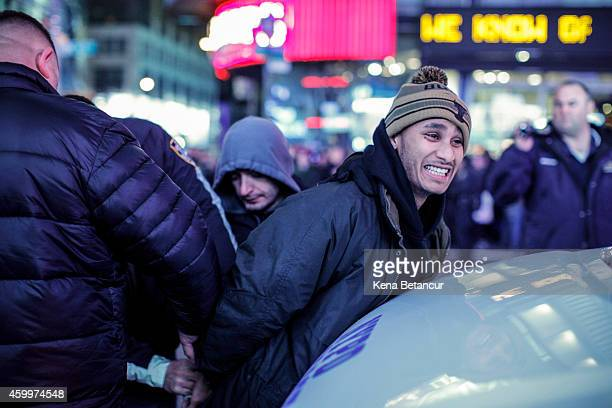 A demonstrator is arrested during a protest following yesterday's decision by a Staten Island grand jury not to indict a police officer who used a...