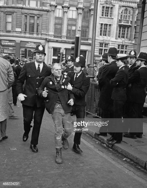 A demonstrator is arrested during a rally attended by fifteen thousand people in support of the 198485 Miner's Strike London 24th February 1985