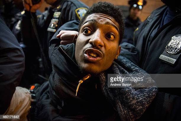 A demonstrator is arrested inside the Barclays Center subway station after a Brooklyn Nets game while protesting the Staten Island New York grand...