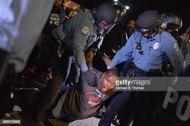 A demonstrator is detained and arrested during a protest outside the Ferguson Police Department on March11 2015 in Ferguson MO Protests erupted after...