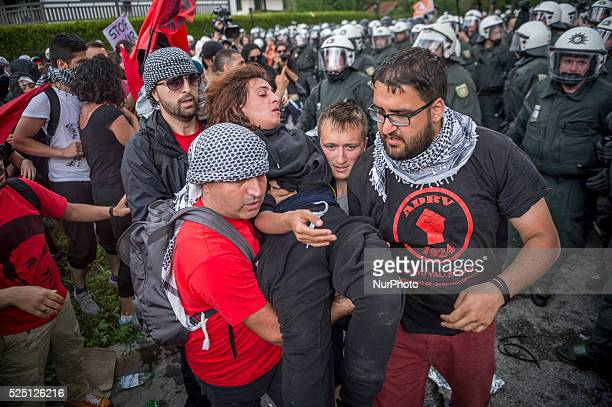 Demonstrator is evacuated after smoke bombs were used during a rally in Garmisch-Partenkirchen, southern Germany on June 6 ahead of the G7 summit....