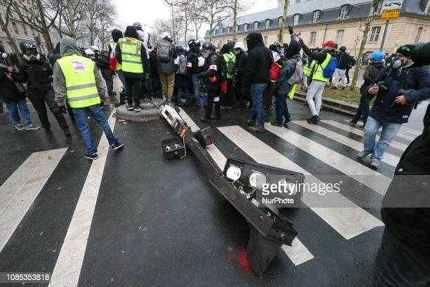 A demonstrator is injured and is lying on the street in front of the Hotel national voice over Invalides in Paris on January 19 2019 during a...