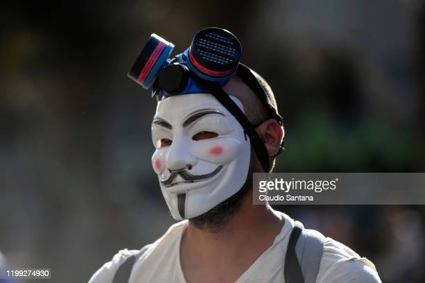 A demonstrator is masked like Guy Fawkes during a protest against President Sebastian Piñera's policies and the police forces violence on February 7...
