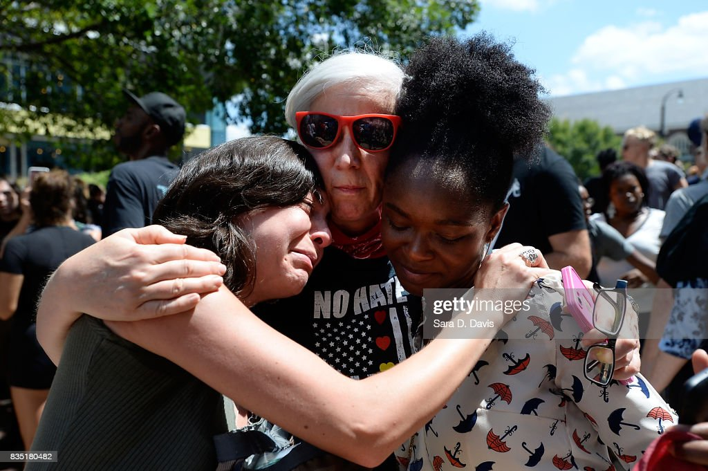 A demonstrator is overcome with emotion during a march in reaction to a potential white supremacists rally on August 18, 2017 in Durham, North Carolina. The demonstration comes a week after a fatal clash during a 'Unite the Right' rally between white supremacists and counter protesters in Charlottesville, Virginia.