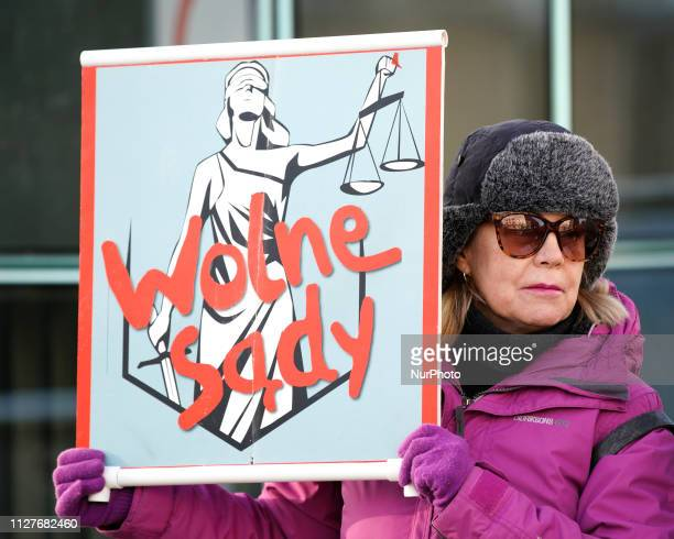 A demonstrator is pcitured holding a sign with the words quotFree Courtsquot in front of the Supreme Court in Warsaw Poland on February 27 2019...