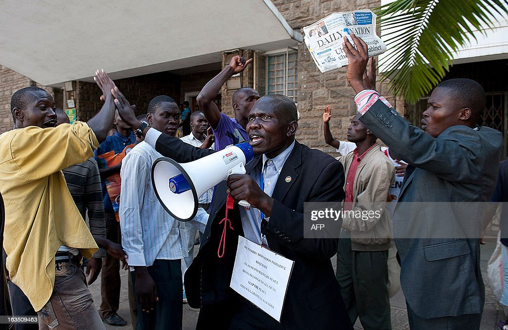 A demonstrator is pictured with a megaphone during a protest in support of outgoing Prime Minister outside the supreme court in Nairobi on March 11, 2013. Raila Odinga who challenged newly elected Uhuru Kenyatta during Kenya's recent Presidential elections is in the process of preparing a supreme court appeal against the election results alleging fraud. AFP PHOTO/Jennifer Huxta