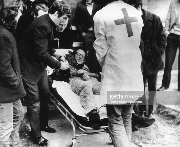 A demonstrator is placed on a stretcher after the Bloody Sunday massacre in Derry Northern Ireland 30th January 1972