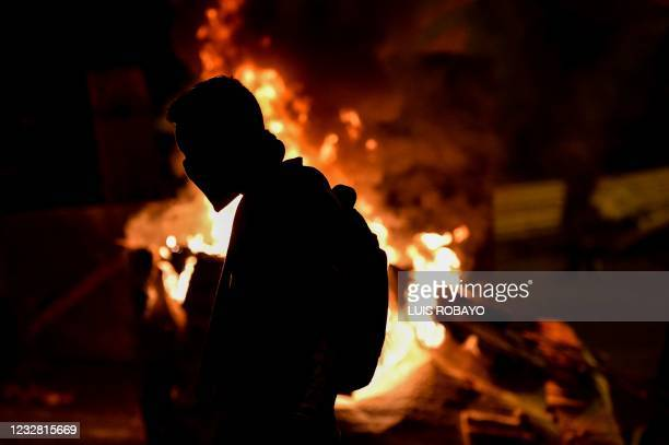 Demonstrator is seen at a barricade blocking a street during a protest against the government in Cali, Colombia, on May 10, 2021. - Faced with angry...