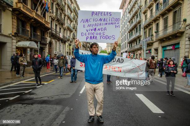 A demonstrator is seen carrying a sign with the text Nationality housing and rights for all during the demonstration against job insecurity in...