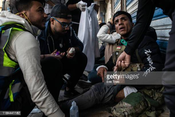 A demonstrator is treated for an injury near Ahrar Bridge where there have been recent clashes between demonstrators and Iraq security forces on...