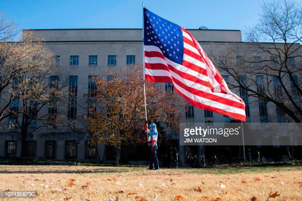 Demonstrator Jim Griffin the self proclaimed true Captain America walks with a giant American Flag outside the US District Court in Washington DC...