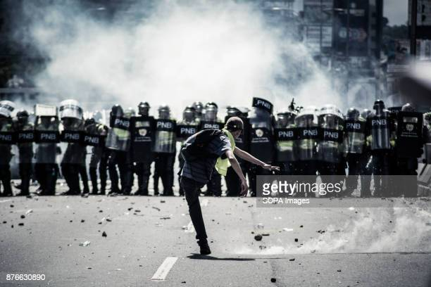 A demonstrator kicks back a tear gas canister to the Bolivarian National Police Venezuela is going through the worst political and humanitarian...