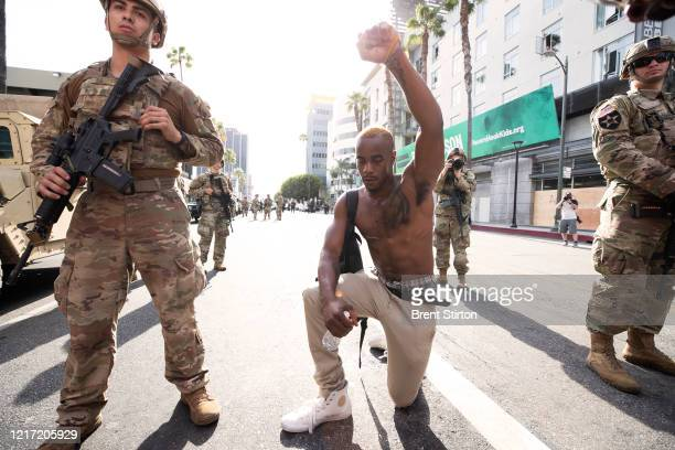 A demonstrator kneels during a march in response to George Floyd's death on June 2 2020 in Los Angeles California Floyd died while in Minneapolis...