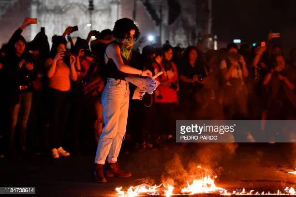 A demonstrator lights a fire during a protest on the commemoration of the International Day for the Elimination of Violence Against Women in Mexico...