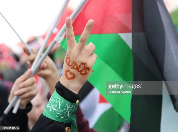A demonstrator makes a victory sign written on the hand 'Kudus' during the Jerusalem Belongs to Islam rally held by members of non governmental...