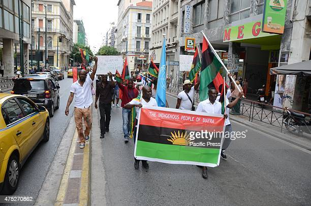 Demonstrator march through the streets of Athens A rally in the center of Athens organized from Biafrans that live in Greece to commemorate the...