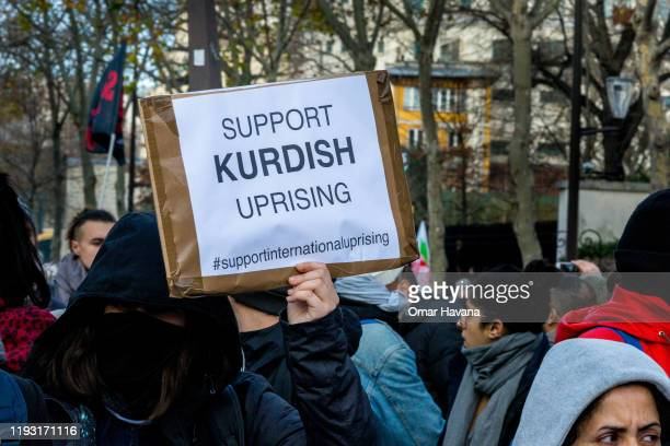 A demonstrator marches carrying a sign in support of the Kurdish people during the sixth day of a general strike on December 10 2019 in Paris France...