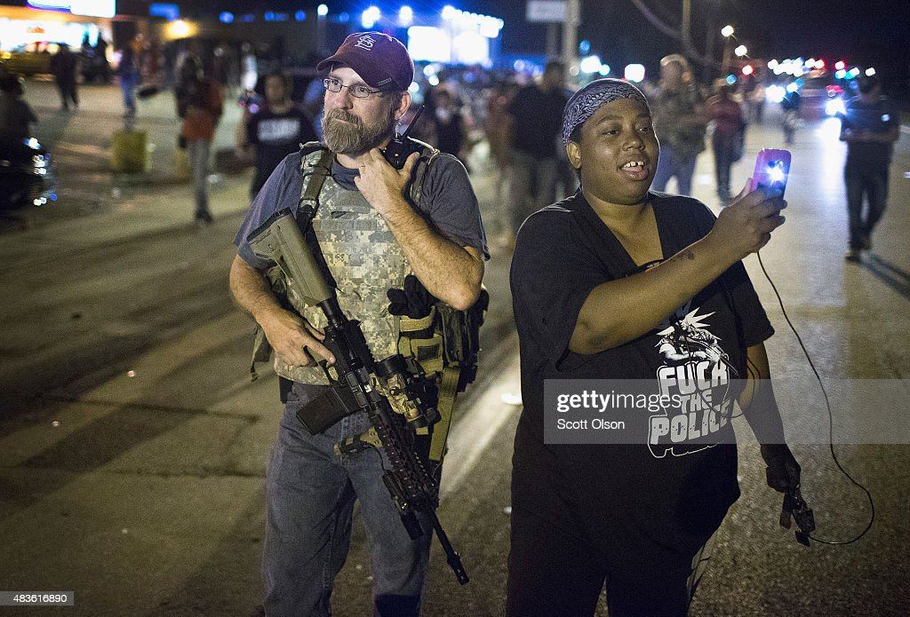 Ferguson Tense After Shootout On Anniversary Of Michael Brown's Death : News Photo
