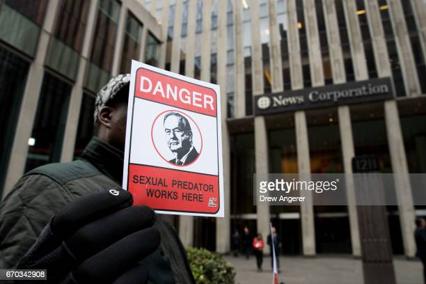 Demonstrator Matt Mitchell holds a sign outside of the News Corp and Fox News headquarters in Midtown Manhattan April 19 2017 in New York City 21st...